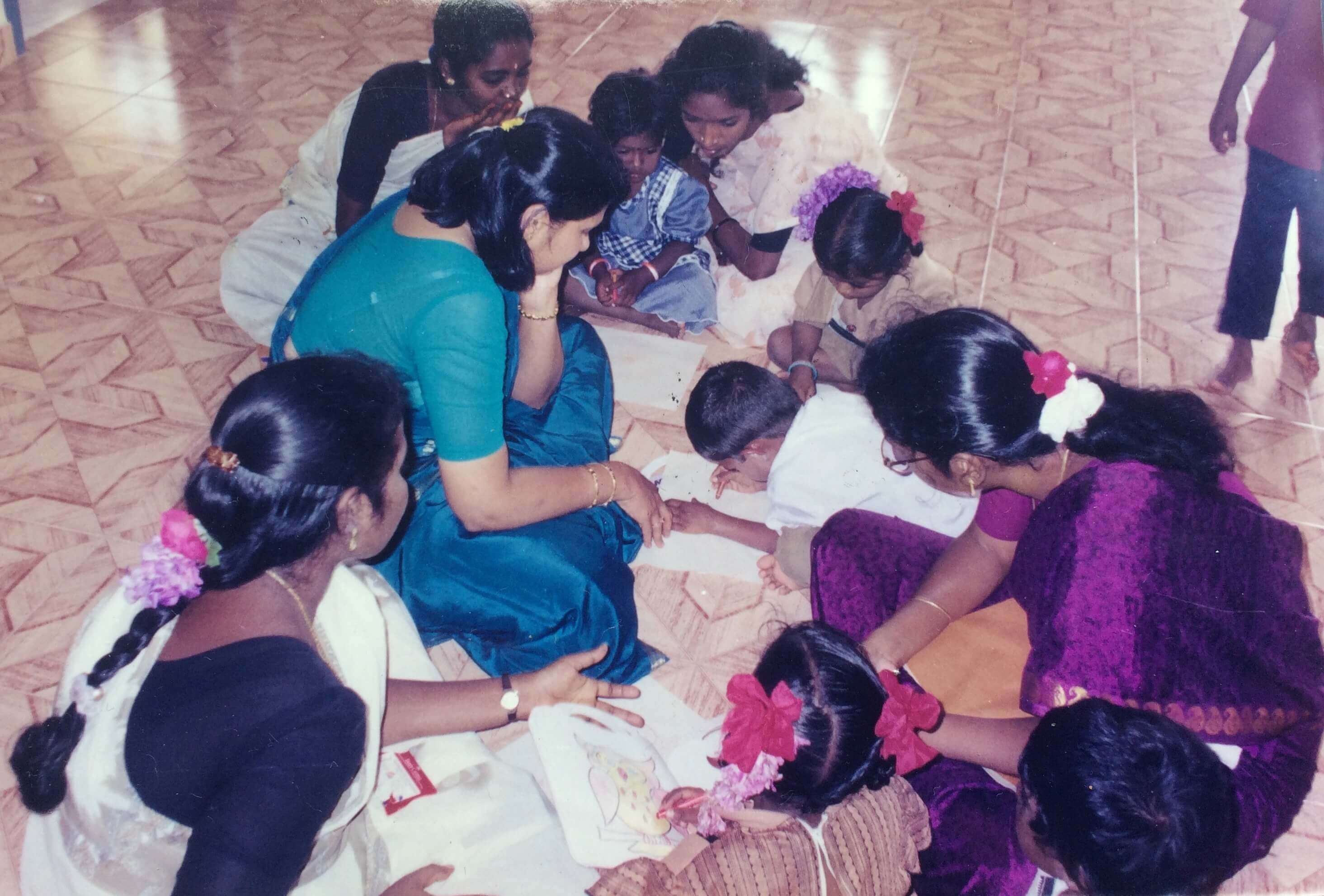 Children learning to draw and colour at Child Development Centre in Irumaram